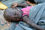Its face covered with flies, a displaced child sleeps in Agok, a town in the contested Abyei region where tens of thousands of people fled in 2011 after an attack by soldiers and militias from the northern Republic of Sudan on most parts of Abyei. Although the 2005 Comprehensive Peace Agreement called for residents of Abyei--which sits on the border between Sudan and South Sudan--to hold a referendum on whether they wanted to align with the north or the newly independent South Sudan, the government in Khartoum and northern-backed Misseriya nomads, excluded from voting as they only live part of the year in Abyei, blocked the vote and attacked the majority Dinka Ngok population. The African Union has proposed a new peace plan, including a referendum to be held in October 2013, but it has been rejected by the Misseriya and Khartoum.