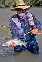 Fly fisherman with rainbow trout. Owyhee River, Oregon.