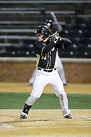 Jonathan Pryor (11) of the Wake Forest Demon Deacons at bat against the Delaware Blue Hens at Wake Forest Baseball Park on February 13, 2015 in Winston-Salem, North Carolina.  The Demon Deacons defeated the Blue Hens 3-2.  (Brian Westerholt/Four Seam Images)