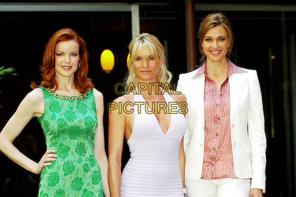 "MARCIA CROSS, NICOLLETTE SHERIDAN  & BRENDA STRONG .""Desperate Housewives"" Cast Photocall, Rome, Itlay, .June 27th 2005..half length white ribbed halterneck dress green patterned print gold stones jacket pink shirt Nicolette.Ref: CAV.www.capitalpictures.com.sales@capitalpictures.com.©Luca Cavallari/Capital Pictures."