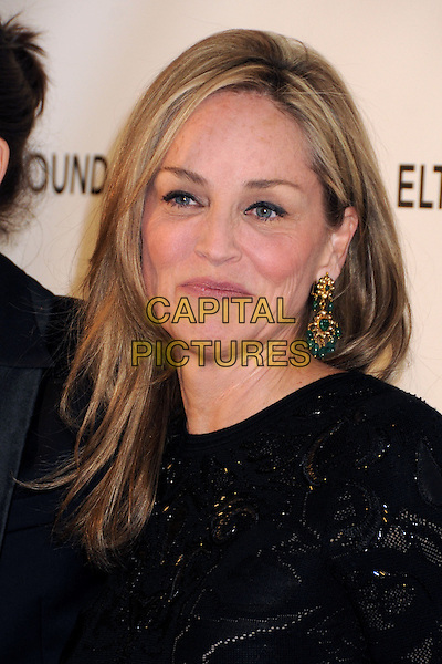 Sharon Stone.21st Annual Elton John Academy Awards Viewing Party held at West Hollywood Park, West Hollywood, California, USA..February 24th, 2013.oscars headshot portrait lace dangling blue gold earring black.CAP/ADM/BP.©Byron Purvis/AdMedia/Capital Pictures.