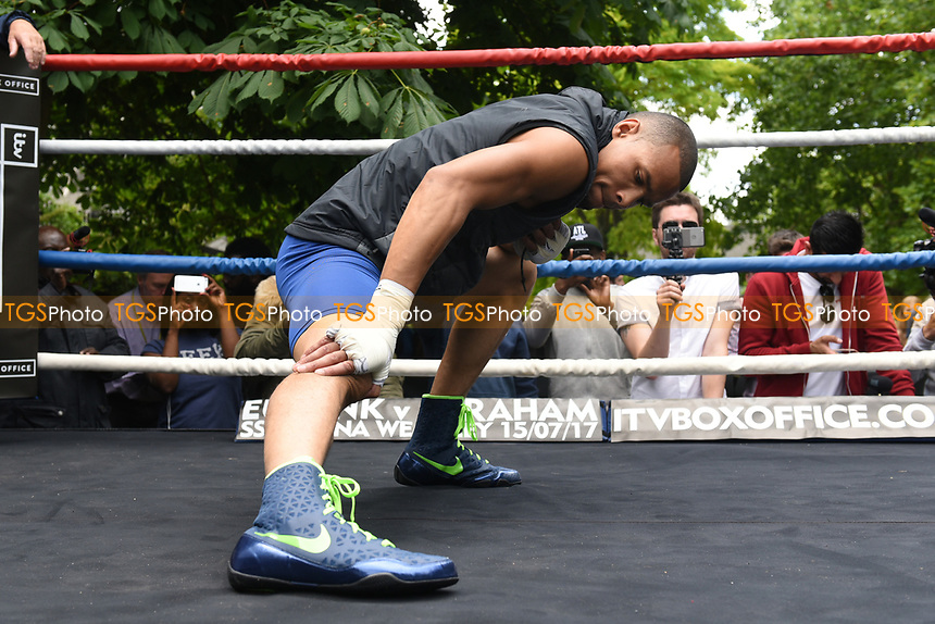 Chris Eubank Jnr stretches during a Public Work Out at ITV Head Office on 12th July 2017