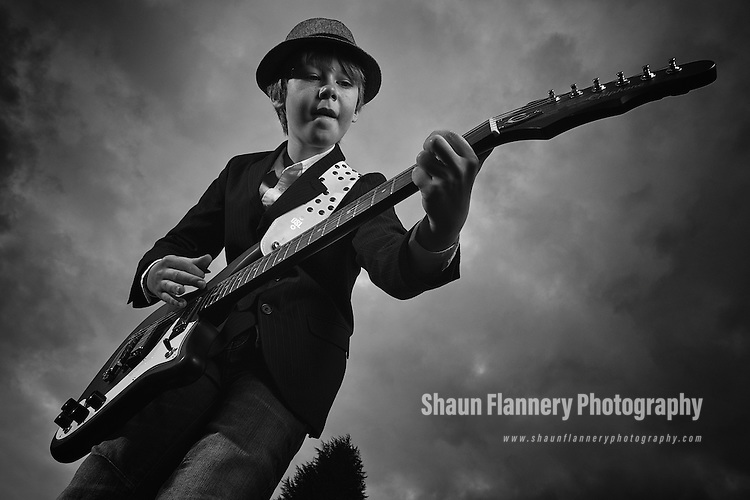 Pix: Shaun Flannery/shaunflanneryphotography.com...COPYRIGHT PICTURE>>SHAUN FLANNERY>01302-570814>>07778315553>>..29th January 2012……………..A young person plays an Epiphone 1966 Worn Wilshire electric guitar against a moody grey sky.