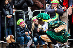 Kids meet Black Peter at Sinterklaas parade, Dam Square, Amsterdam, 14th November 2010. Sinterklaas, the basis for Santa Claus in other countries, arrives from Spain by boat,  accompanied by Black Peter, played by multitudes of white Dutch people in blackface - a tradition that evokes some controversy. Contrary to traditions of Santa Claus elsewhere, Sinterklass arrives by boat, then rides through the streets on his grey horse, Amerigo,  in mid-November, bringing in the Christmas season. The Zwarte Pieten (Black Peters) distribute sweets and gingerbread cookies to the crowd along the parade route.