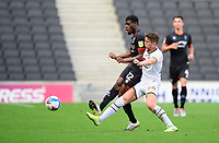 Lincoln City's Timothy Eyoma vies for possession with Milton Keynes Dons' Jordan Houghton<br /> <br /> Photographer Chris Vaughan/CameraSport<br /> <br /> The EFL Sky Bet League One - Milton Keynes Dons v Lincoln City - Saturday 19th September 2020 - Stadium MK - Milton Keynes<br /> <br /> World Copyright © 2020 CameraSport. All rights reserved. 43 Linden Ave. Countesthorpe. Leicester. England. LE8 5PG - Tel: +44 (0) 116 277 4147 - admin@camerasport.com - www.camerasport.com