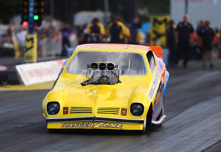 Jun 4, 2016; Epping , NH, USA; The NHRA nostalgia funny car named Danger Zone races during qualifying for the New England Nationals at New England Dragway. Mandatory Credit: Mark J. Rebilas-USA TODAY Sports