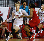 VERMILLION, SD - MARCH 27, 2016 -- Nicole Seekamp #35 of South Dakota drives past Tashia Brown #10 of Western Kentucky during their WNIT game Sunday evening at the Dakotadome in Vermillion, S.D.  (Photo by Dick Carlson/Inertia)