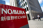 August 3, 2012 - Tokyo, Japan - Businessmen walk out the the Nomura Holdings Inc. building in the Shinjuku district of Tokyo. Japan regulators ordered Nomura Holdings Inc. to improve its internal security operations over the recent insider info trading scandal, after two of Nomura's top executives resigned to take responsibility for this incident. (Photo by Christopher Jue/AFLO)