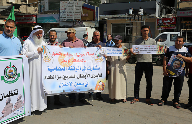 Palestinian supporters of the Hamas movment, take part in protest to show solidarity with prisoners on hunger strike in Israeli jails, in Nusseirat refugee camp in the central Gaza Strip on September 21, 2019. Photo by Ashraf Amra