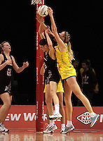 23.09.2012 Silver Ferns Anna Harrison and Australian Caitlin Bassett in action during the third netball test match between the Silver Ferns and the Australian Diamonds at CBS Canterbury Arena in Christchurch. Mandatory Photo Credit ©Michael Bradley.