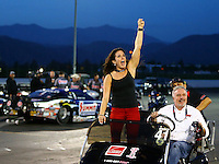 Nov 16, 2014; Pomona, CA, USA; Courtney Enders , sister of NHRA pro stock driver Erica Enders-Stevens celebrates after clinching the 2014 pro stock championship and winning the Auto Club Finals at Auto Club Raceway at Pomona. Mandatory Credit: Mark J. Rebilas-USA TODAY Sports