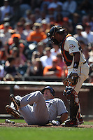 SAN FRANCISCO - SEPTEMBER 28:  Ty Wigginton #21 of the Colorado Rockies falls to the ground after getting hit by a pitch against the San Francisco Giants during the game at AT&T Park on September 28, 2011 in San Francisco, California. Photo by Brad Mangin