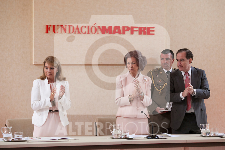 Queen Sofia of Spain (R), Mapfre Foundation President Antonio Huertas and the Social Services Secretary Susana Camarero during the Mapfre Foundation Social Awards ceremony at Mapfre Campus in Madrid, Spain. May 20, 2014. (ALTERPHOTOS/Victor Blanco)