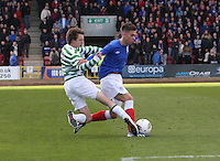 Aidan Nesbitt tackling Ryan Sinnamon in the Celtic v Rangers City of Glasgow Cup Final match played at Firhill Stadium, Glasgow on 29.4.13,  organised by the Glasgow Football Association and sponsored by City Refrigeration Holdings Ltd..