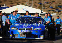 Apr 11, 2008; Avondale, AZ, USA; Crew members push the car of NASCAR Sprint Cup Series driver Ryan Newman through the garage during practice for the Subway Fresh Fit 500 at Phoenix International Raceway. Mandatory Credit: Mark J. Rebilas-