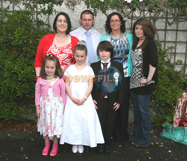 Cousins Orla McEvoy and Liam Woods and family at Termonfeckin NS Communion....Photo NEWSFILE/Jenny Matthews.(Photo credit should read Jenny Matthews/NEWSFILE)....This Picture has been sent you under the condtions enclosed by:.Newsfile Ltd..The Studio,.Millmount Abbey,.Drogheda,.Co Meath..Ireland..Tel: +353(0)41-9871240.Fax: +353(0)41-9871260.GSM: +353(0)86-2500958.email: pictures@newsfile.ie.www.newsfile.ie.FTP: 193.120.102.198.