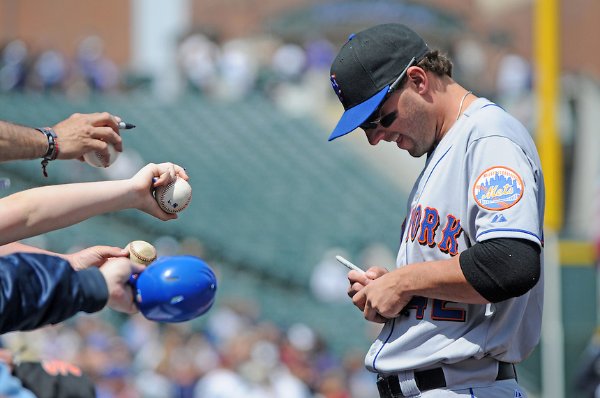 15 April 2010: New York Mets right fielder Jeff Francoeur signs autographs for fans during a regular season Major League Baseball game between the Colorado Rockies and the New York Mets at Coors Field in Denver,  Colorado. The Mets defeated the Rockies 5-0 on Jackie Robinson day.  *****For Editorial Use Only*****