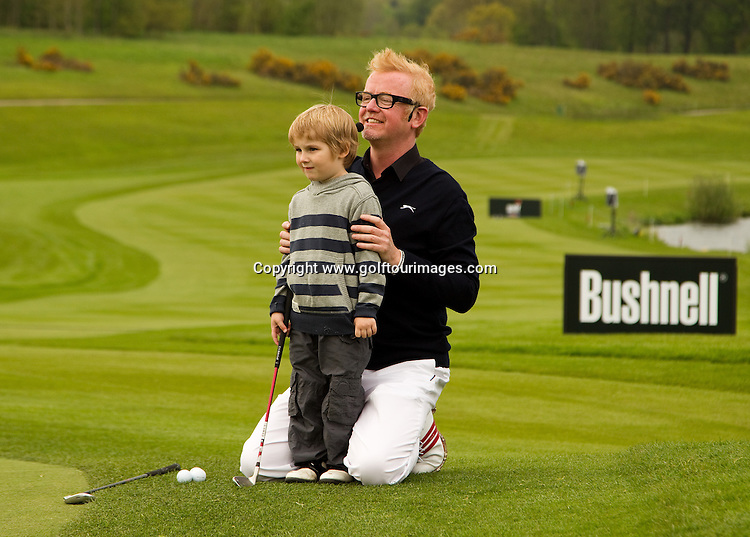 Chris Evans with help from his 5 year old team captain Jayden take part in the beat the pro challenge as paft of Golf Live which took place at The London Club, Brands Hatch, Kent from 18th to 20th May 2012: Picture Stuart Adams www.golftourimages.com: 20th May 2012