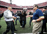 Ohio State Buckeyes head coach Urban Meyer goes to shake hands with Michigan Wolverines head coach Brady Hoke following the NCAA football game at Ohio Stadium on Nov. 29, 2014. The Buckeyes won 42-28. (Adam Cairns / The Columbus Dispatch)