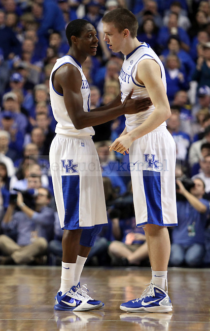 Brandon Knight talks with Jon Hood as he comes on the court in the first half of UK vs. Florida  at Rupp Arena on Saturday, Feb. 26, 2011.  Photo by Britney McIntosh | Staff