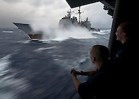 111224-N-DR144-299 PACIFIC OCEAN (Dec. 24, 2011) Hull Technician Fireman Douglas Anderson, left, and Hull Technician Fireman Patrick Zembol, right, watch from a sponson aboard Nimitz-class aircraft carrier USS Carl Vinson (CVN 70) as Ticonderoga-class guided-missile cruiser USS Bunker Hill (CG 52) takes on fuel in heavy seas during a refueling at sea. Carl Vinson and Carrier Air Wing (CVW) 17 are currently underway on a Western Pacific deployment.  (U.S. Navy photo by Mass Communication Specialist 2nd Class James R. Evans/Released).