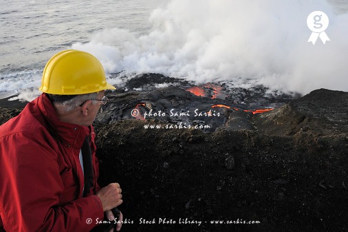 Senior man watching lava flowing to sea, Kilauea volcano, Big Island, Hawaii (sunrise) (Licence this image exclusively with Getty: http://www.gettyimages.com/detail/85071271 )