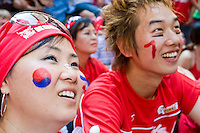 South Korea fans gather by the hundreds to watch their team play against France on June 18, 2006 on a giant outdoor television in a section of New York City known as &quot;Korea Way&quot;.<br /> <br /> The World Cup, held every four years in different locales, is the world's pre-eminent sports tournament in the world's most popular sport, soccer (or football, as most of the world calls it).  Qualification for the World Cup is open to any country with a national team accredited by FIFA, world soccer's governing body. The first World Cup, organized by FIFA in response to the popularity of the first Olympic Games' soccer tournaments, was held in 1930 in Uruguay and was participated in by 13 nations.    <br /> <br /> As of 2010 there are 208 such teams.  The final field of the World Cup is narrowed down to 32 national teams in the three years preceding the tournament, with each region of the world allotted a specific number of spots.  <br /> <br /> The World Cup is the most widely regularly watched event in the world, with soccer teams being a source of national pride.  In most nations, the whole country is at a standstill when their team is playing in the tournament, everyone's eyes glued to their televisions or their ears to the radio, to see if their team will prevail.  While the United States in general is a conspicuous exception to the grip of World Cup fever there is one city that is a rather large exception to that rule.  In New York City, the most diverse city in a nation of immigrants, the melting pot that is America is on full display as fans of all nations gather in all possible venues to watch their teams and celebrate where they have come from.