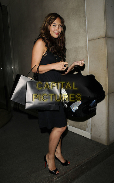MYLEENE KLASS.The Mothercare: Baby K range launch event, Metropolitan Hotel, London, England..May 20th, 2008.full length black dress goody bags car seat .CAP/CAN.©Can Nguyen/Capital Pictures.