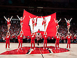 March 3, 2010: Wisconsin Badgers mascot Bucky Badger and the cheerleaders perform during a Big Ten Conference NCAA basketball game against the Iowa Hawkeyes at the Kohl Center on March 3, 2010 in Madison, Wisconsin. The Badgers won 67-40. (Photo by David Stluka)