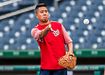 15 August 2017: Washington Nationals Assistant Athletic Trainer John Hsu works with infield drills prior to a game against the Los Angeles Angels at Nationals Park in Washington, DC. The Nationals defeated the Angels 3-1 in the first game of their 2-game series. Mandatory Credit: Ed Wolfstein Photo *** RAW (NEF) Image File Available ***