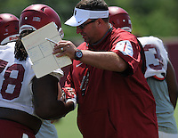 NWA Democrat-Gazette/ANDY SHUPE<br /> Arkansas coach Bret Bielema greets defensive lineman Bijhon Jackson Saturday, Aug. 8, 2015. during practice at the university football practice field in Fayetteville.