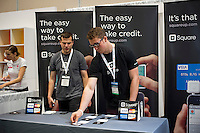 A booth at a trade show promotes their mobile credit card processing system, Square, in New York on Thursday, October 25, 2012.   (© Frances M. Roberts)ts)