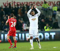 Monday 16 March 2015<br /> Pictured: Swansea's Ashley Williams applauds the crowd as he leaves the field<br /> Re: Barclay's Premier League, Swansea City FC v Liverpool at the Liberty Stadium, south Wales, UK.