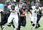 SIOUX FALLS, SD - NOVEMBER 10: Gabriel Watson #33 from the University of South Falls breaks loose past Jacob Protzman #97 and Ryan Parker #94 from Wayne State during their game Saturday afternoon at Bob Young Field in Sioux Falls. (Photo by Dave Eggen/Inertia)