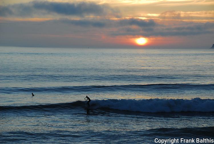 Surfing at sunset at Half Moon Bay SB