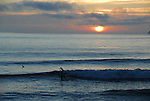 Surfing at sunset at Half Moon Bay SB