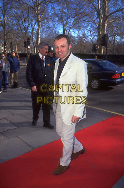 GRAHAM NORTON.Ref:9347.comedian, camp, gay, full length, full-length.*RAW SCAN - photo will be adjusted for publication*.www.capitalpictures.com.sales@capitalpictures.com.© Capital Pictures