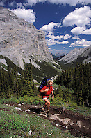 CANADA, ALBERTA, KANANASKIS, MAY 2002. A hiker on the Ribbon Falls Trail. The Kananaskis Country provincial park is home to Canada's most beautiful nature and wildlife. It has also escaped the mass tourism as in Banff National Park. Photo by Frits Meyst/Adventure4ever.com
