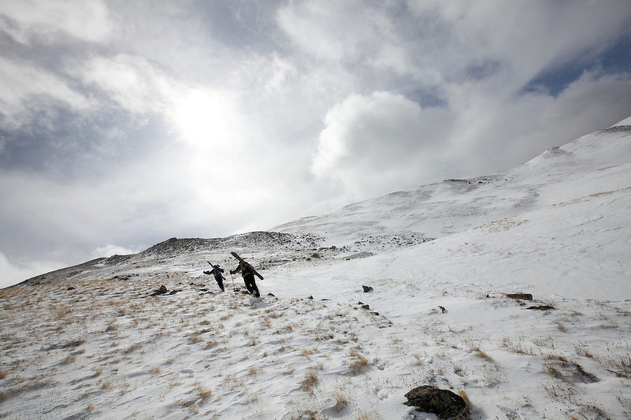A pair of skiers heads into the backcountry near Loveland Pass, Colorado, for some early season skiing.