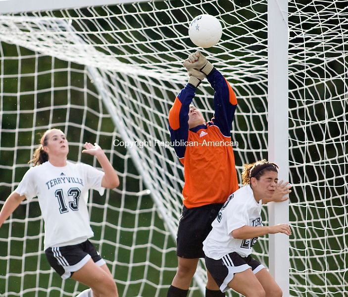 TERRYVILLE, CT - 17 SEPTEMBER 2009 -091709JT16-<br /> Terryville's Shelby Bissonette makes a save with support from teammates Tori Pilbin, left, and Gabby Roberts during Thursday's game at Terryville. The Chiefs won, 3-1.<br /> Josalee Thrift Republican-American