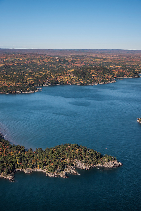 Aerial photography of  the rugged Lake Superior shoreline north of Marquette, Michigan during fall color season.