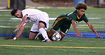 WATERBURY  CT. - 14 October 2019-101419SV13- #7 Lucas Silva of Naugatuck High and #11 Kadin Talha of Holy Cross High go down while trying to control the ball during NVL Soccer action in Waterbury Monday.<br />Steven Valenti Republican-American