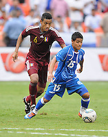 El Salvador midfielder Edwin Sanchez (15) shields the ball against Venezuela midfielder Juan Guerra (6). El Salvador National Team defeated Venezuela 3-2 in an international friendly at RFK Stadium, Sunday August 7, 2011.