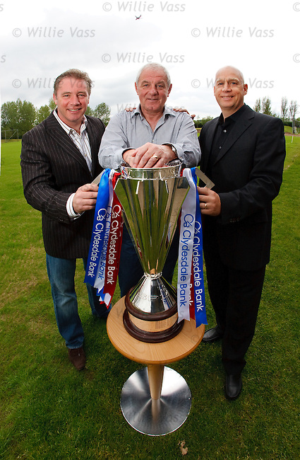 Walter Smith flanked by deputies Ally McCoist and Kenny McDowall with the Scottish Premier League winners trophy at Murray Park
