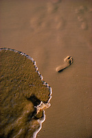 Footprint in sand on an Oahu beach.