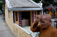 Buddhist monk Thich Hue Tien, 73, prays outside the Giac Vien Pagoda in District 11 in Ho Chi Minh City, Vietnam. Photo taken Monday, May 3, 2010...Kevin German / LUCEO