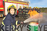 Female firefighter Sinead Galvin shows her colleagues  in Killarney fire brigade l-r: John Grady, Brendan Connors, Martin Grady, Connie Kelly, Anthony Breen, Mike O'Brien and Conor O'Conor how to distinguish a barrel fire in Killarney on Wednesday