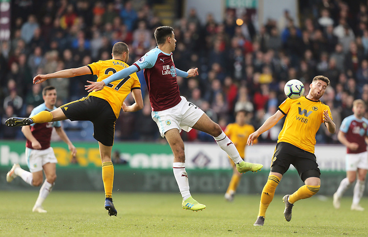 Burnley's Dwight McNeil vies for possession with Wolverhampton Wanderers' Romain Saiss (left) and Matt Doherty<br /> <br /> Photographer Rich Linley/CameraSport<br /> <br /> The Premier League - Burnley v Wolverhampton Wanderers - Saturday 30th March 2019 - Turf Moor - Burnley<br /> <br /> World Copyright © 2019 CameraSport. All rights reserved. 43 Linden Ave. Countesthorpe. Leicester. England. LE8 5PG - Tel: +44 (0) 116 277 4147 - admin@camerasport.com - www.camerasport.com