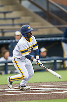 Michigan Wolverines second baseman Ako Thomas (4) follows through on his swing against the Bowling Green Falcons on April 6, 2016 at Ray Fisher Stadium in Ann Arbor, Michigan. Michigan defeated Bowling Green 5-0. (Andrew Woolley/Four Seam Images)
