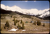 View of Trout Lake just below the dam with Vermillion Peak in background.  The RGS track shows across the lower portion while the water tank is in the distance just left of center.<br /> RGS  Trout Lake, CO  Taken by Maxwell, John W. - 5/31/1946